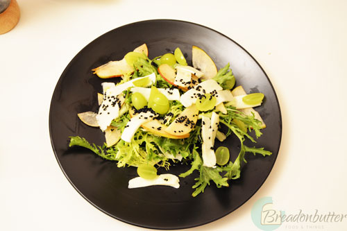 halloumi and niglla seeds salad